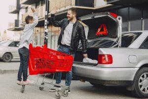 Sales man showing customer a lhd car