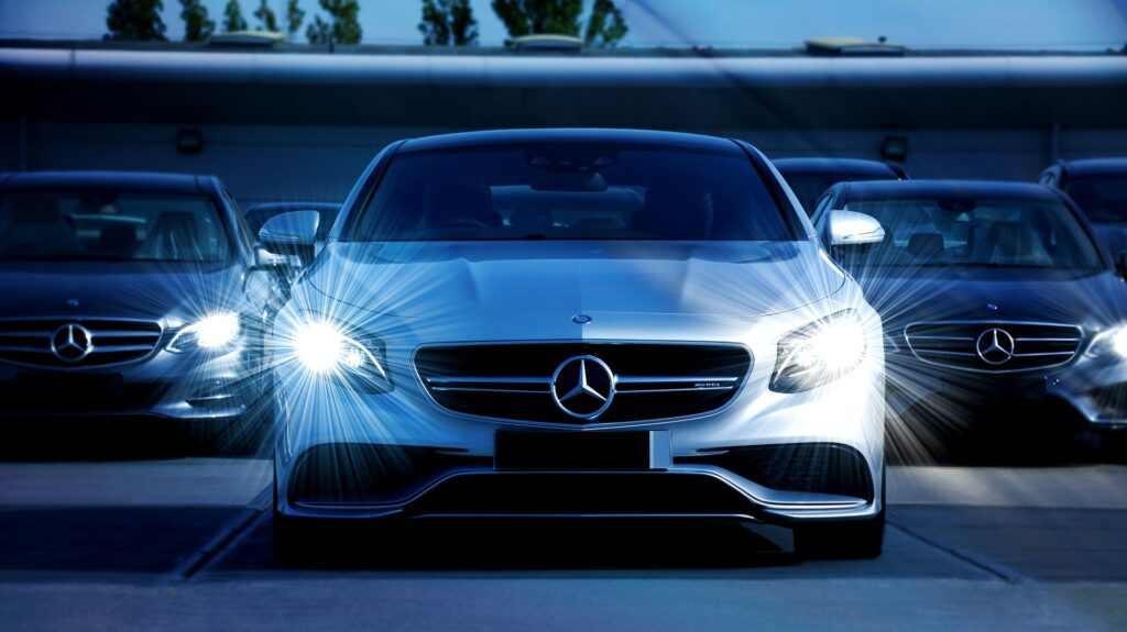 white mercedes benz cars on the road